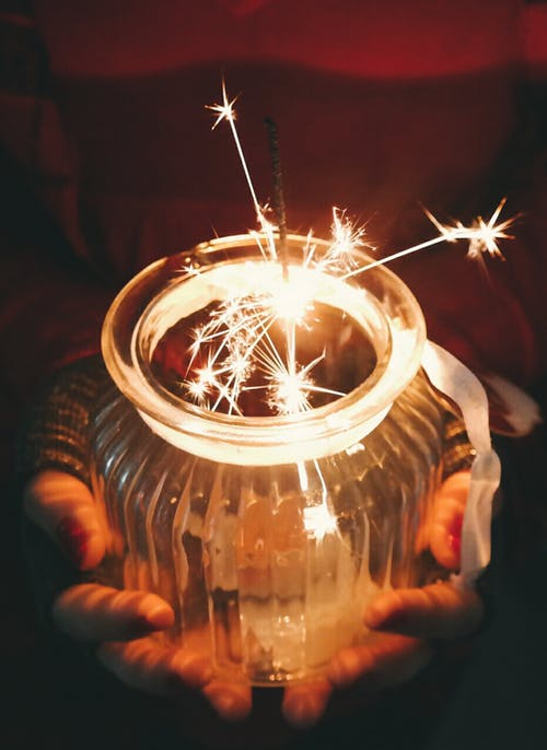 Person Holding Jar With Sparkler