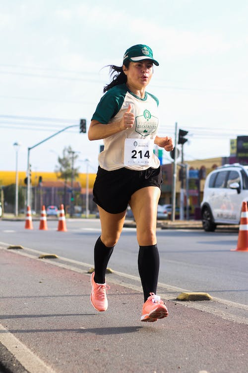 Woman in Number 214 Running on Road
