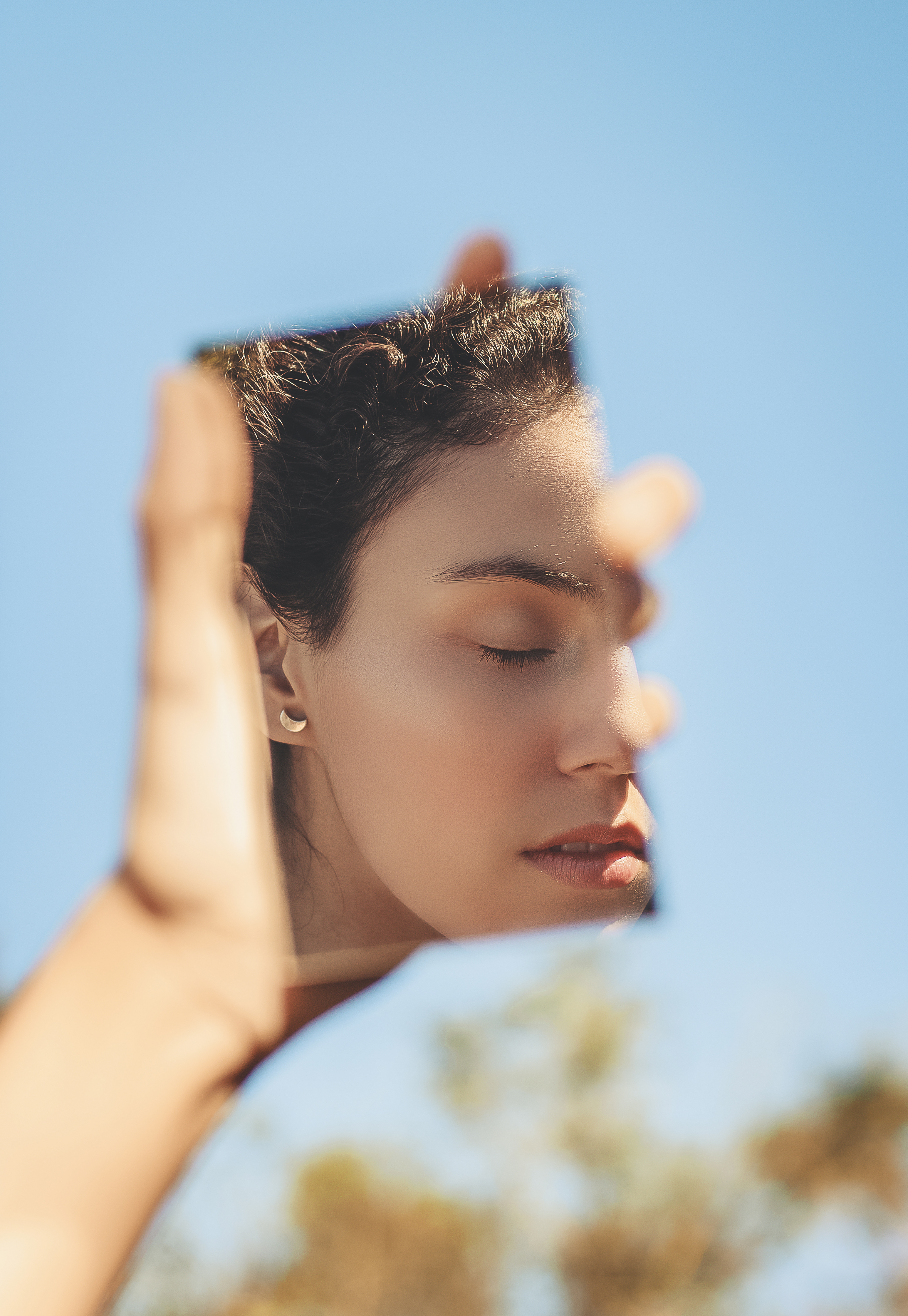 Photo Of Woman's Face In The Mirror