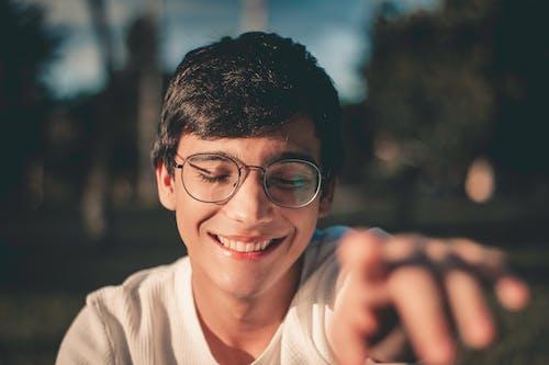 Selective Focus Photography of Smiling Man Wearing Black Framed Eyeglasses