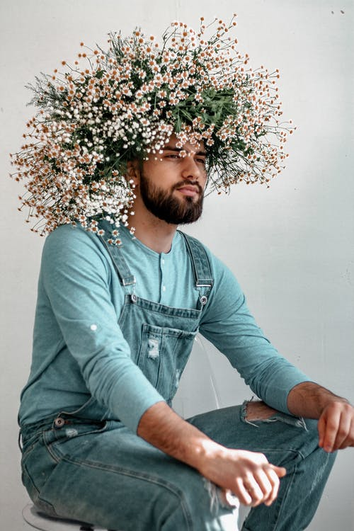 Photo Of Man Wearing Flower Crown