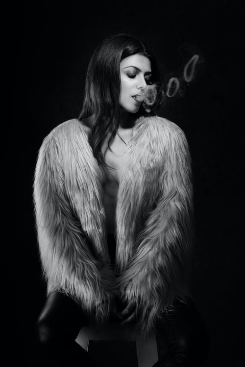 Grayscale Photo of Woman Wearing Fur Jacket