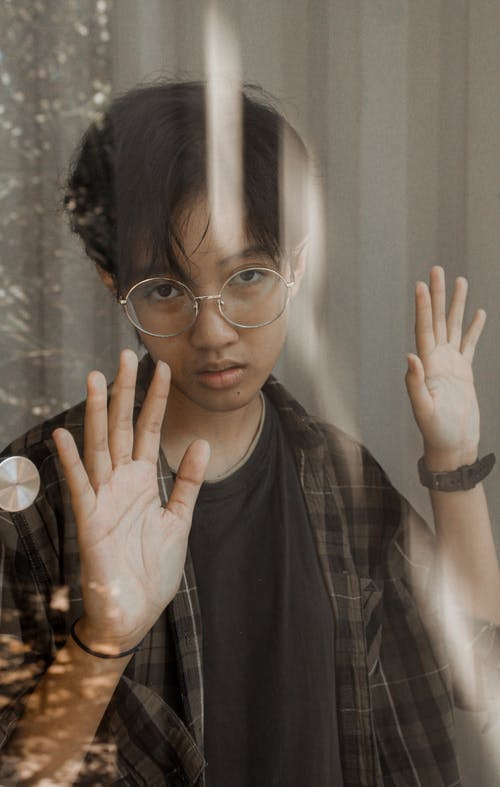 Photo of Boy Leaning On Glass