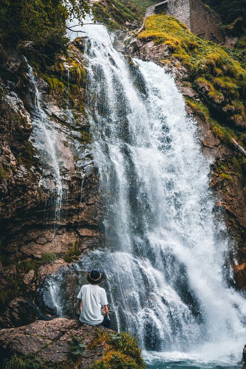 Man Near Waterfalls