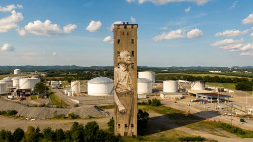 Concrete Building With Mural On An Industrial Plant