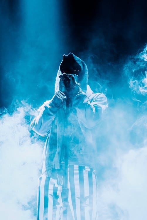 Photo Of Person Standing Around Smokes