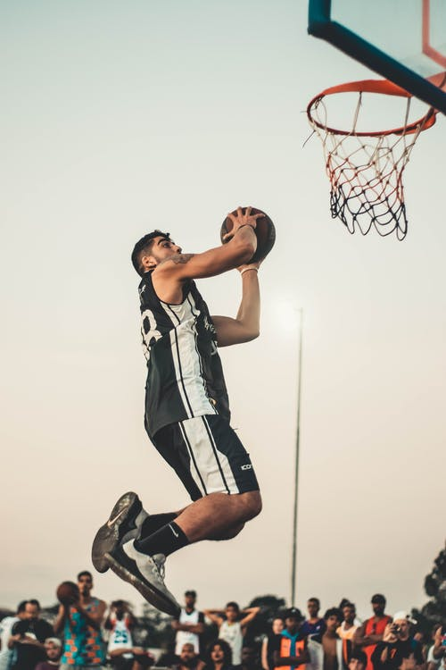 Photo Of Man Doing Dunk