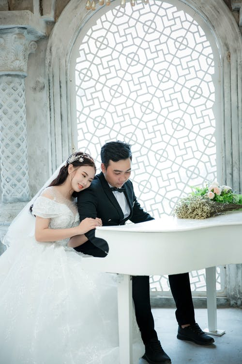 Photo Of Man And Woman Playing Piano