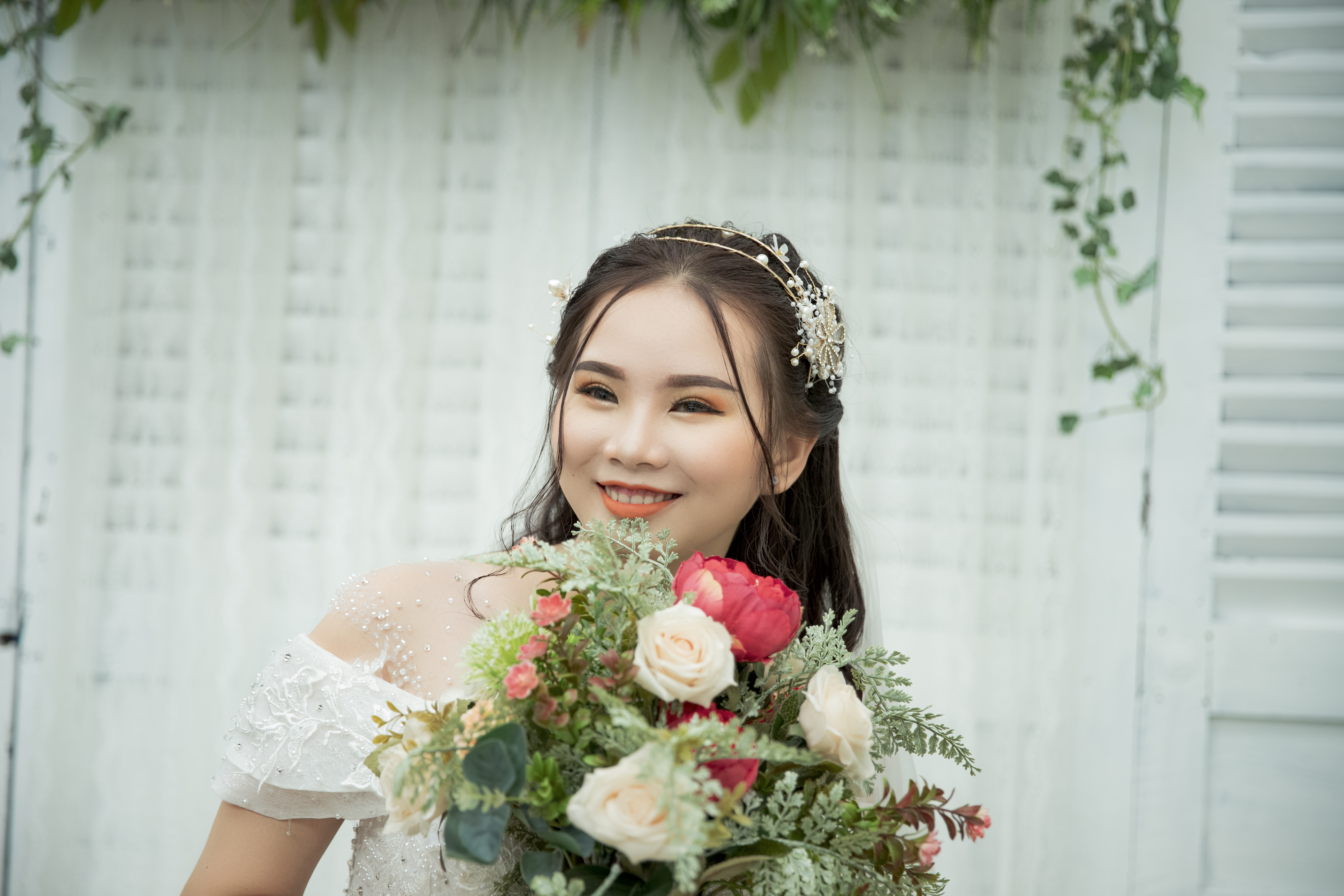 Photo Of Bride Holding Bouquet