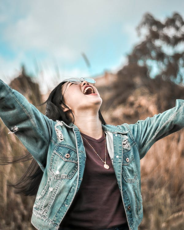 Photo Of Woman Looking Up With Arms Wide Open