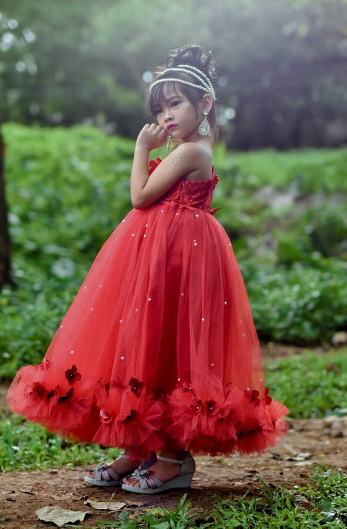 Selective Focus Photography Of Standing Girl In Red Dress