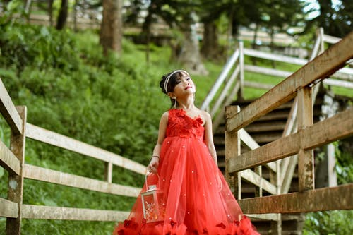 Girl In Red Dress Holding Candle Lantern