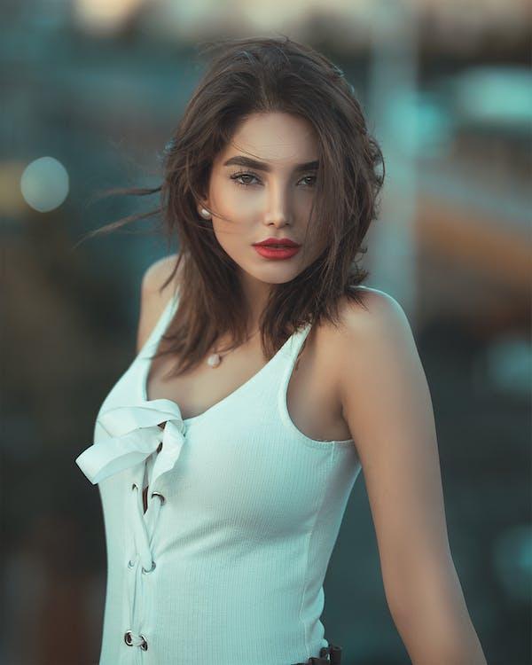 Women Wearing White Tank Top Posing for a Photo