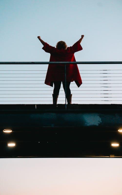 Woman Standing Near Railing