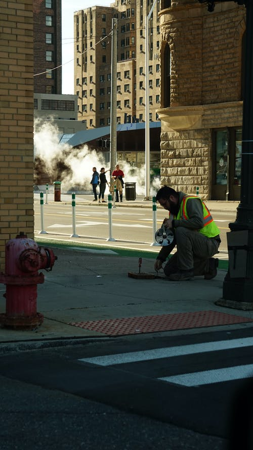 Free stock photo of construction worker, crosswalk, sewer, smoke