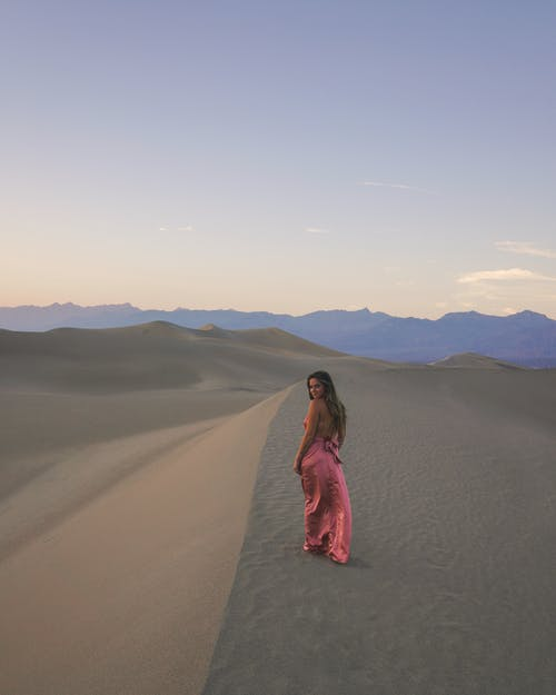 Photo Of Woman Walking On Dessert