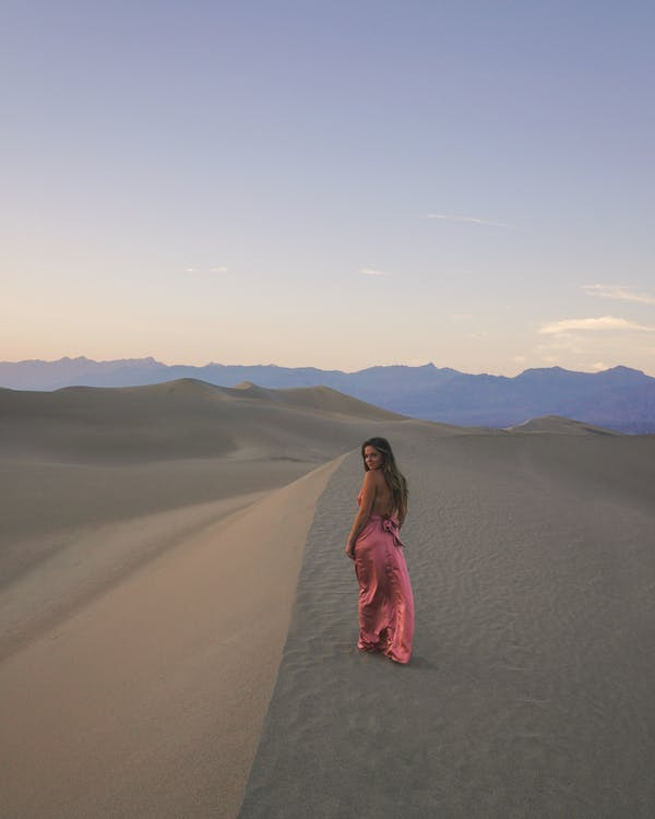 Photo Of Woman Walking On Dessert