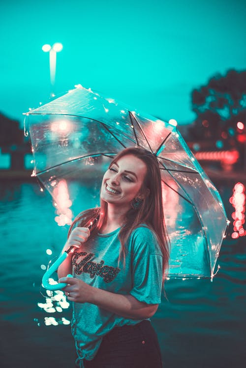 Photo Of Woman Holding An Umbrella