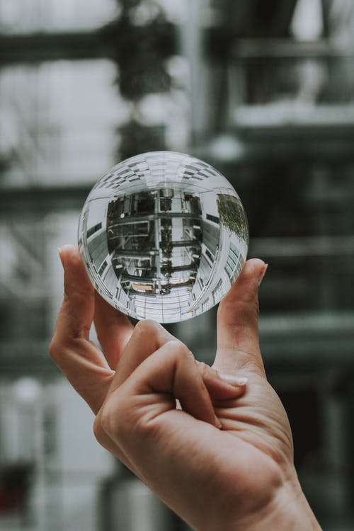 Selective Focus Photography of Clear Glass Ball Ornament