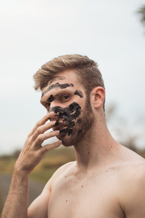 Man Holding His Face