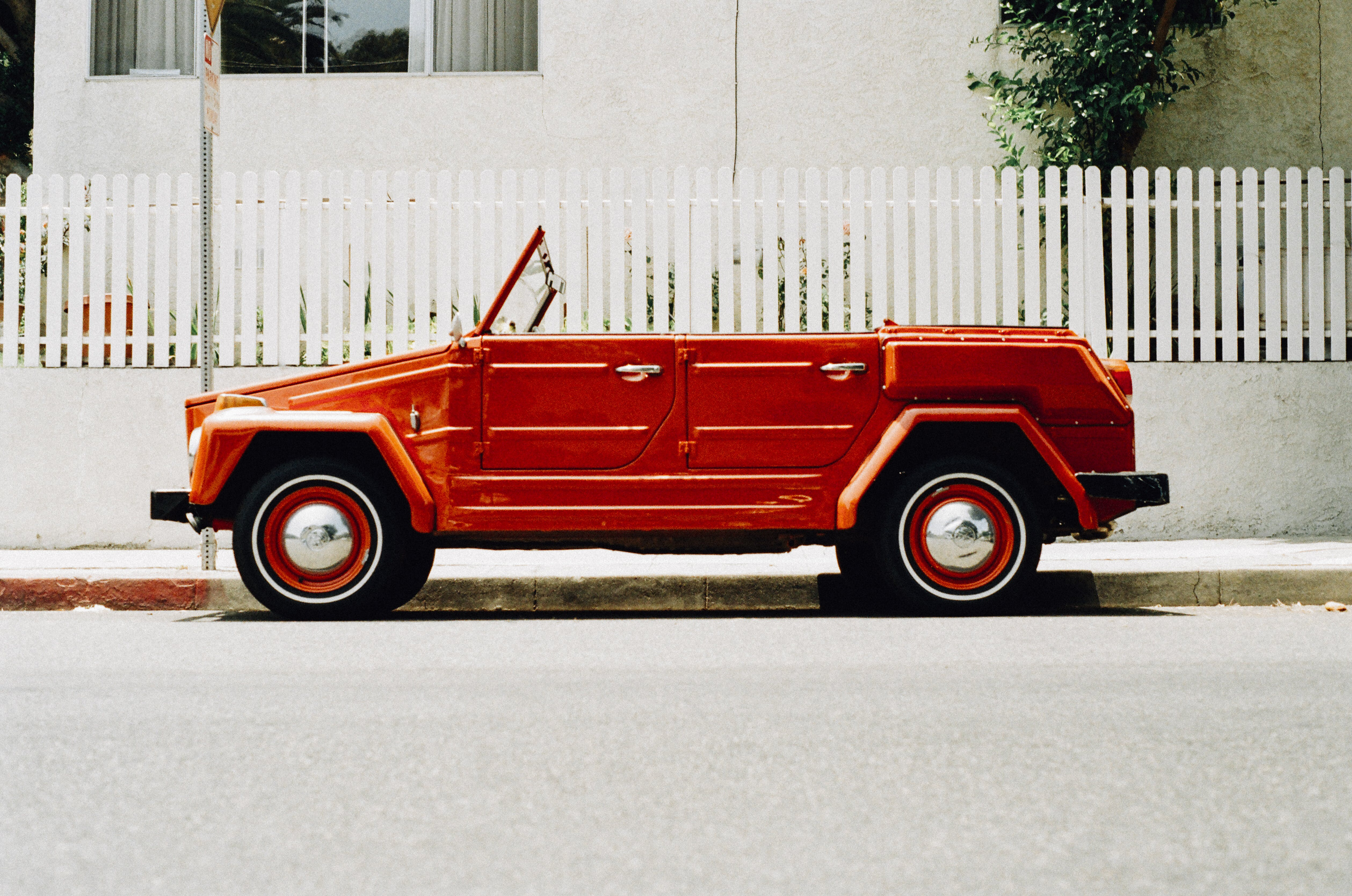 Vintage Red Coupe Parked Beside Gutter