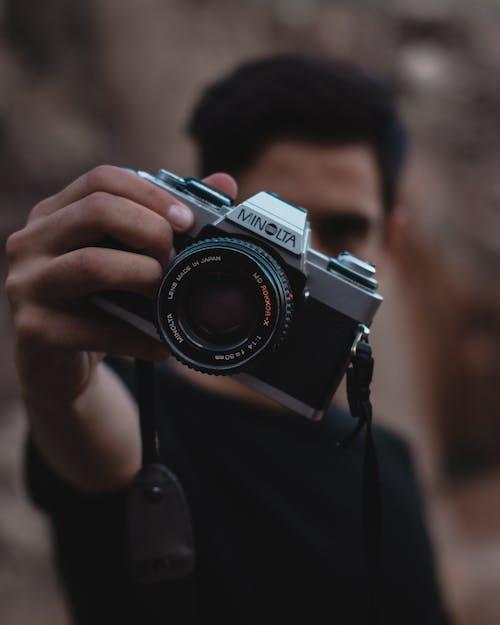 Man Holding Minolta Camera