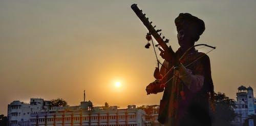 Ingyenes stockfotó indián, naplemente, sziluett, zenész témában