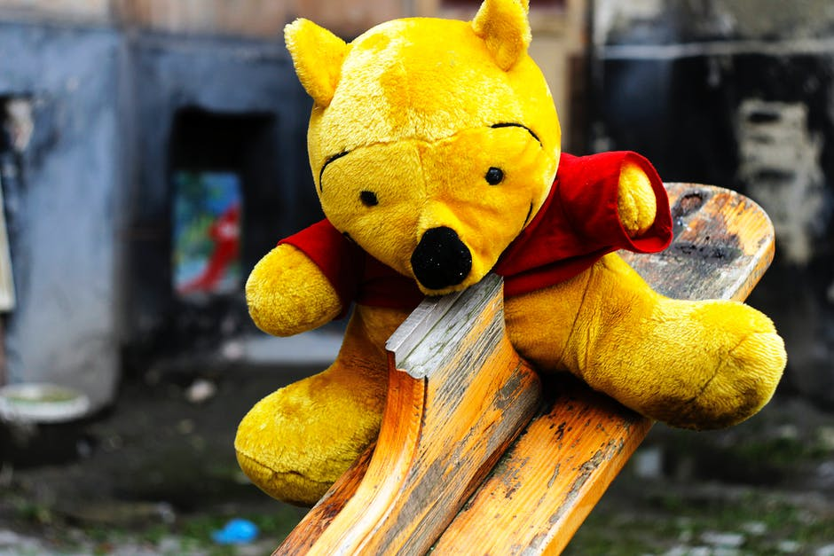 Winnie the Pooh Plush Toy on Seesaw