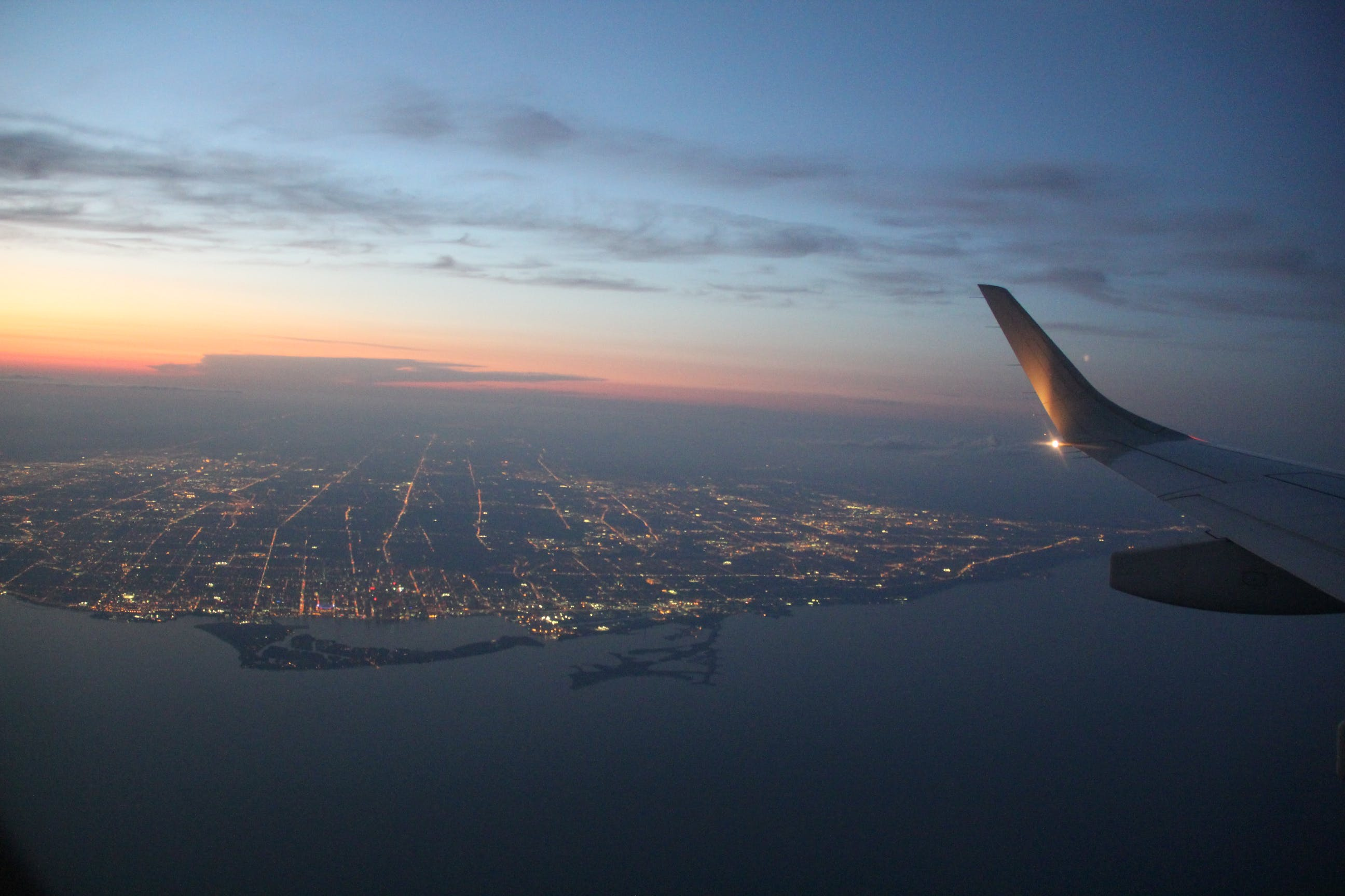 Free stock photo of aircraft window view, Beautiful sunset viewed from airplane, fly high, Nice sunset sky