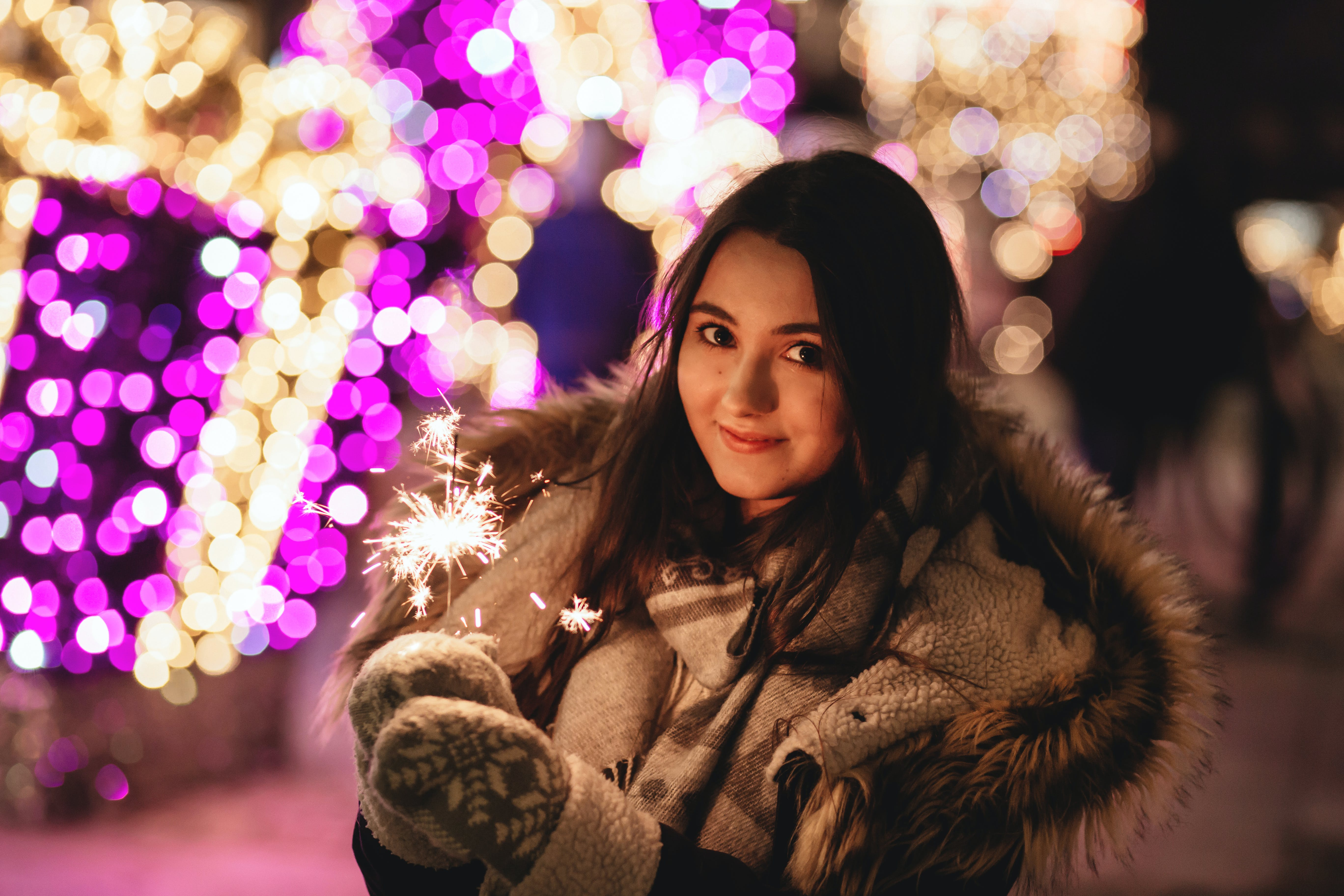 Bokeh Photography of Woman in Brown Parka Jacket