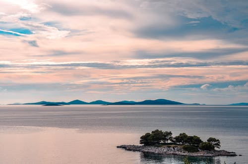 Free stock photo of clouds, island, landscape, pink background