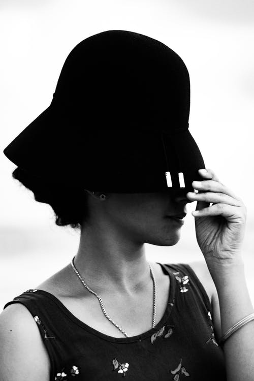 Gray-scale Photo of Woman In Black Bucket Hat