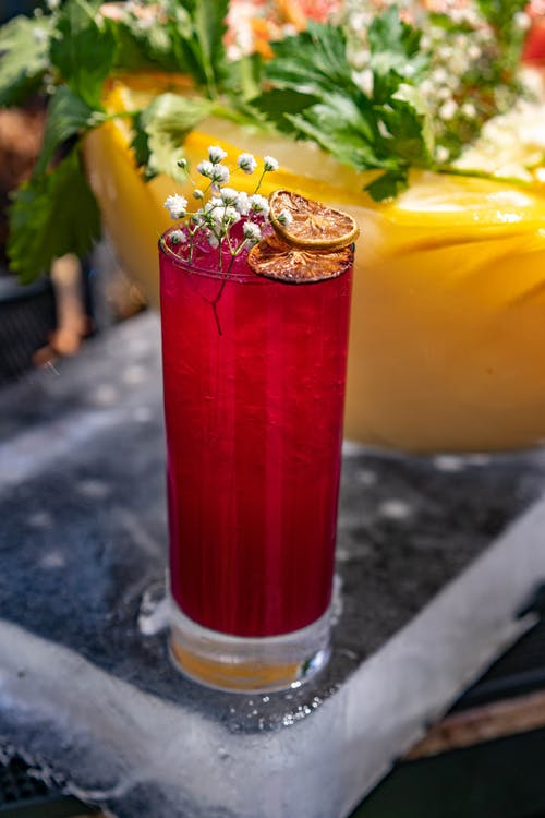 Red Glass  with Garnished Beverage