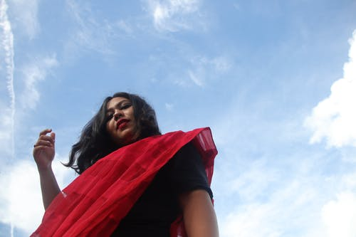 Woman in Black T-shirt With Red Scarf