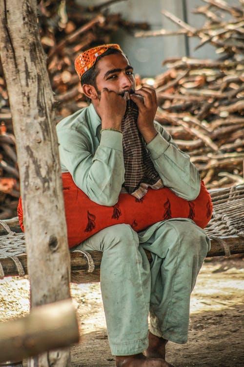 Man Sitting On A Hammock