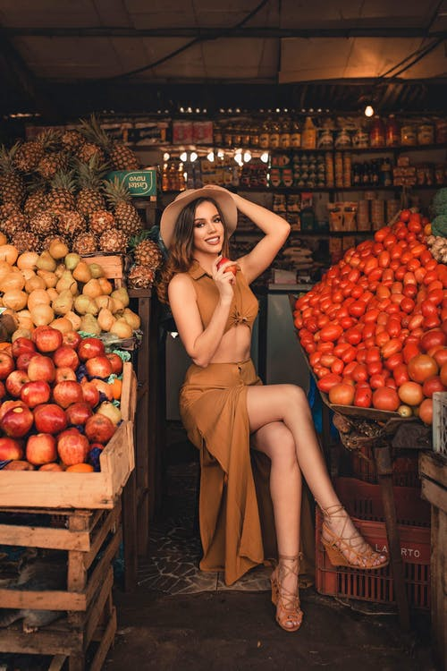 Woman Wearing Brown Top and Skirt Dress on Fruit Store