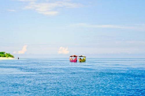 Two Colorful Boats On Calm Seas