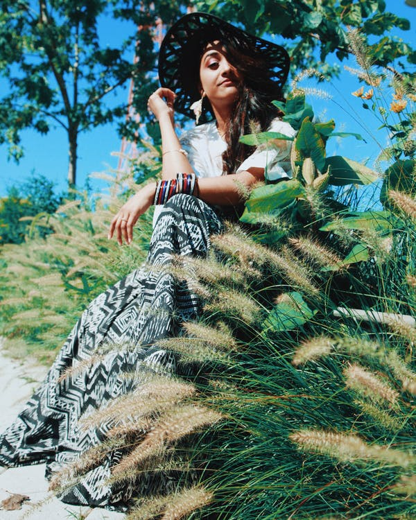 Photo Of Woman Sitting Beside Plants