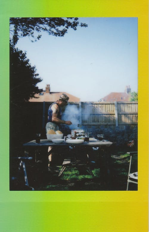 Man Cooking On Grill