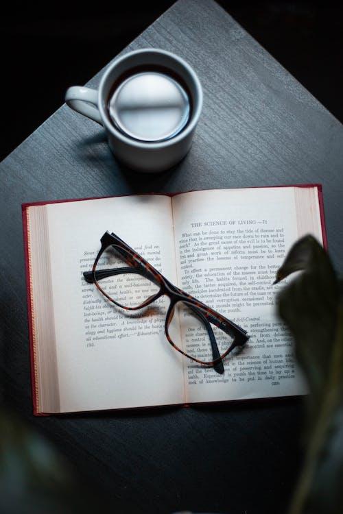 Black Framed Eyeglasses On Book