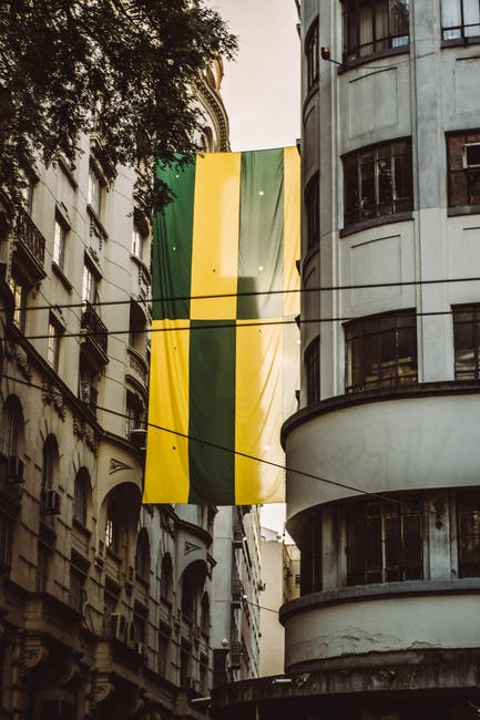 Green and yellow banner on building