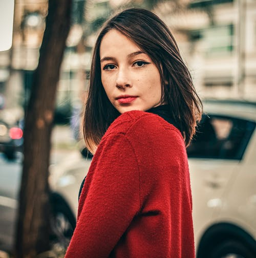 Photo Of Woman Wearing Red Sweater