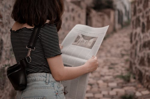 Photo Of Woman Reading Newspaper