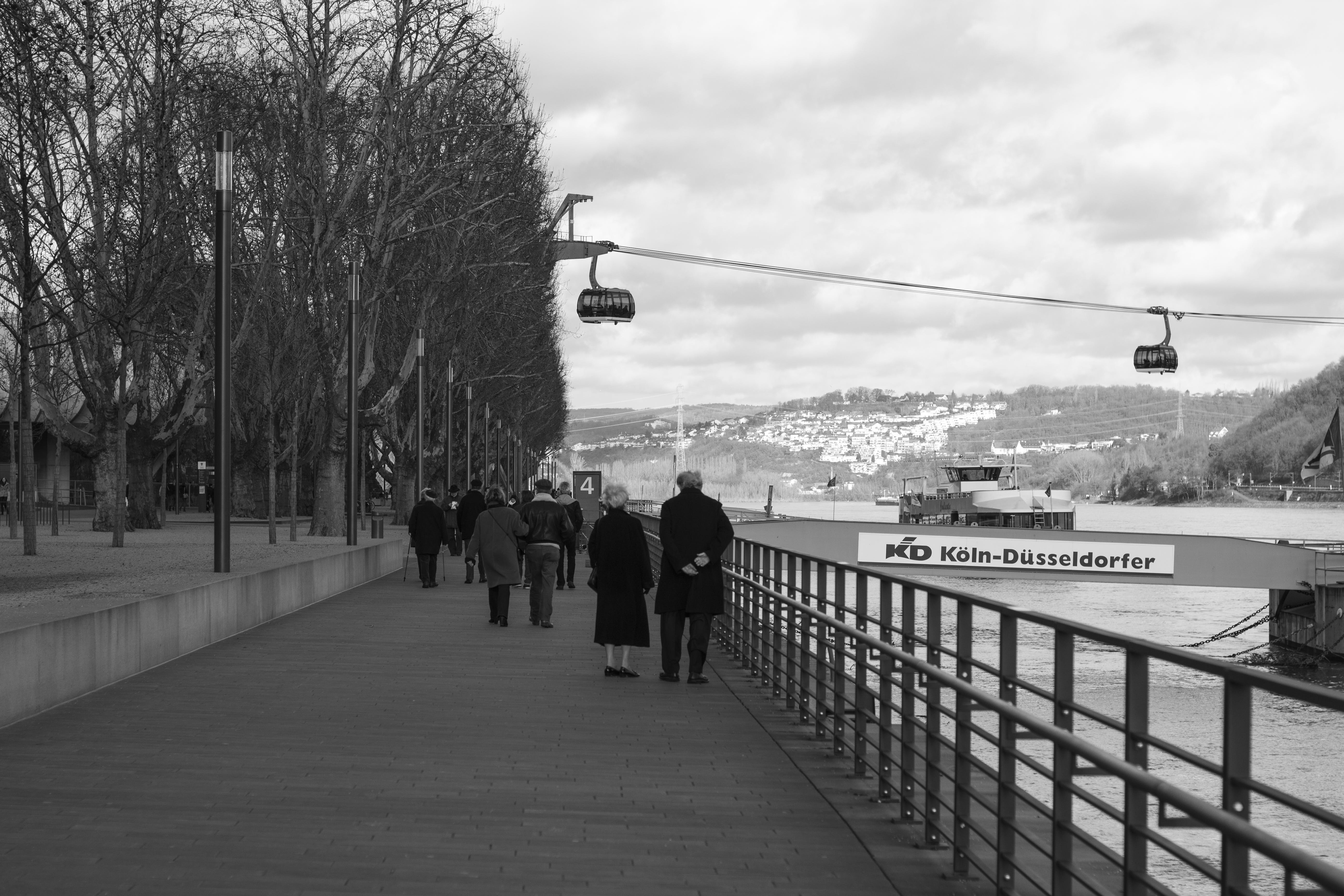 Grayscale Photo of Group of People Walking