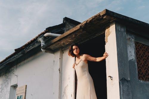 Photo Of Woman Standing In The Doorway