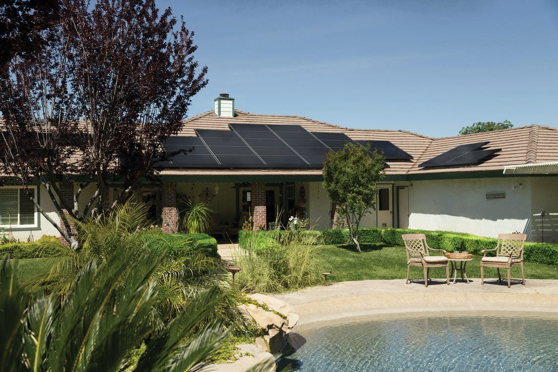 Black Solar Panels On Brown Roof