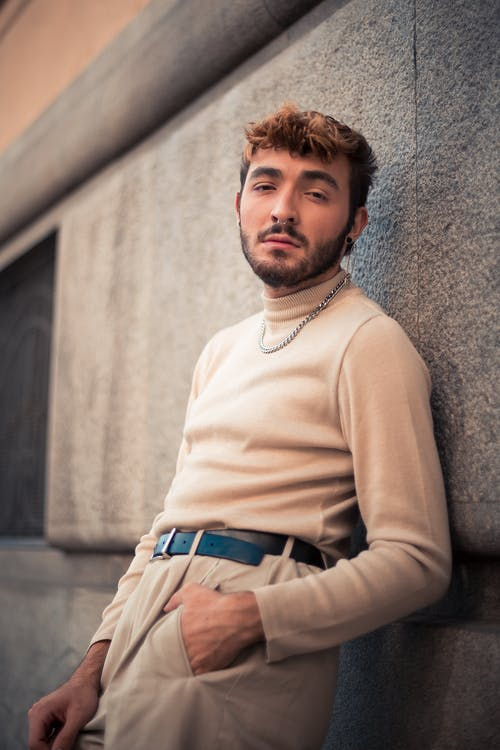 Man In A Beige Turtle Neck Sweater And Pants