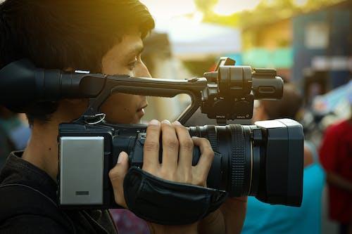 Mann, Der Schwarze Kamera Trägt