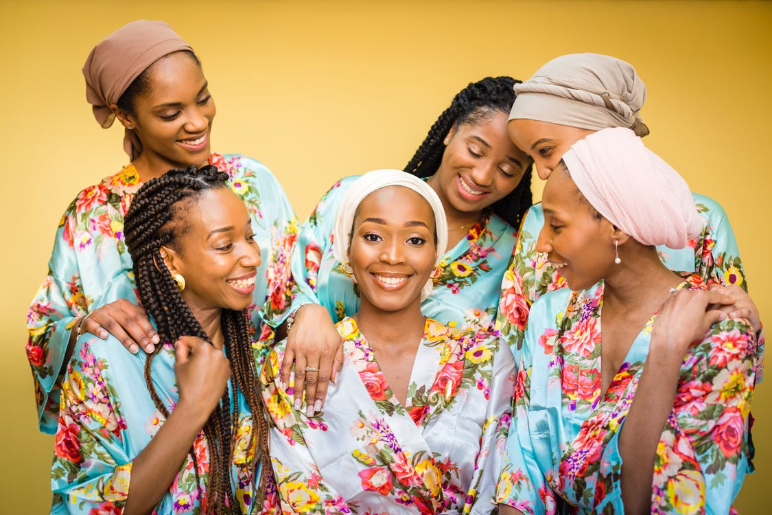 Women In Robes Smiling