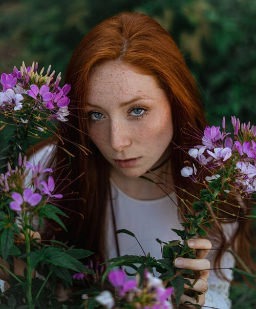 High-Angle Photo of Woman Near Flowers